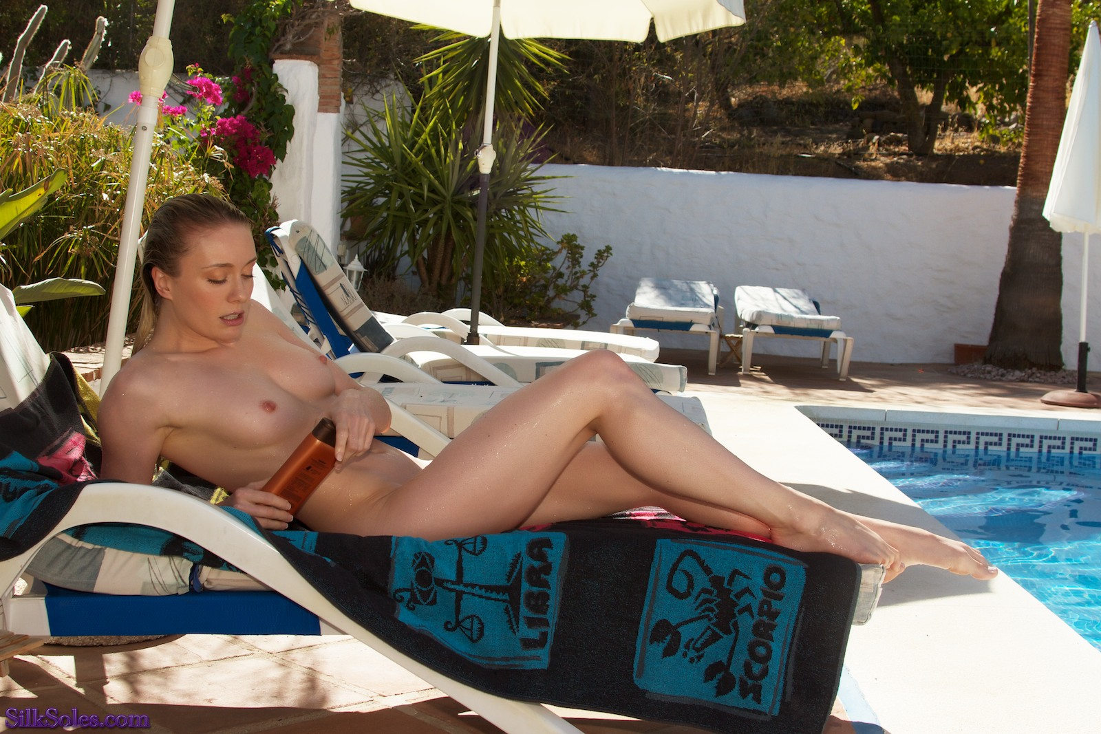 Katy Cee sunbathing in Spain. Obviously, her soles need sun-cream...