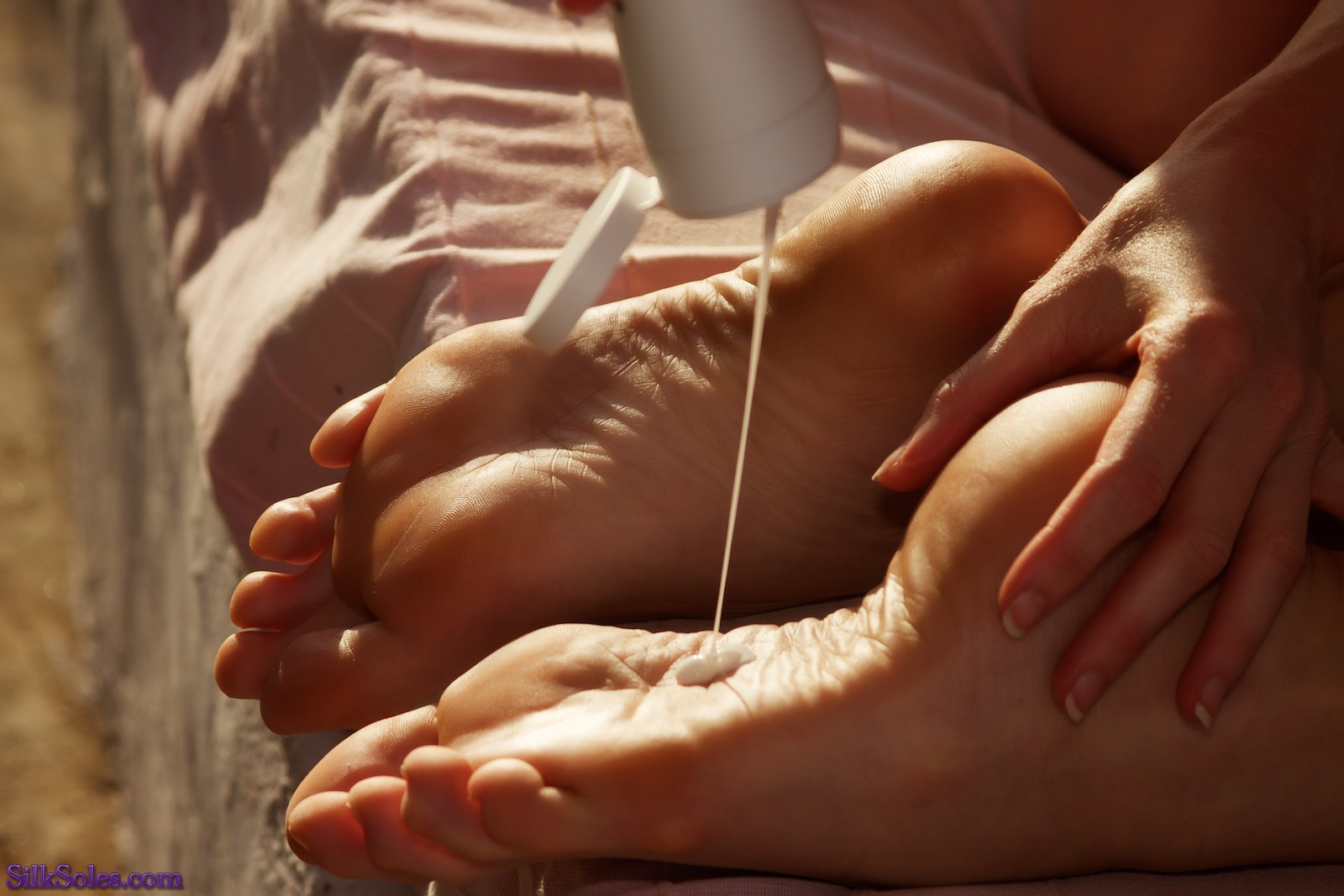 Ahhh, suncream on sexy soles. So much more suggestive than actual foot jobs!